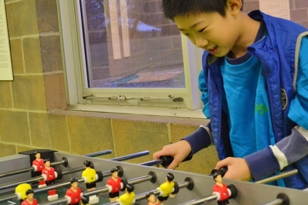 Boy Playing Foos Ball